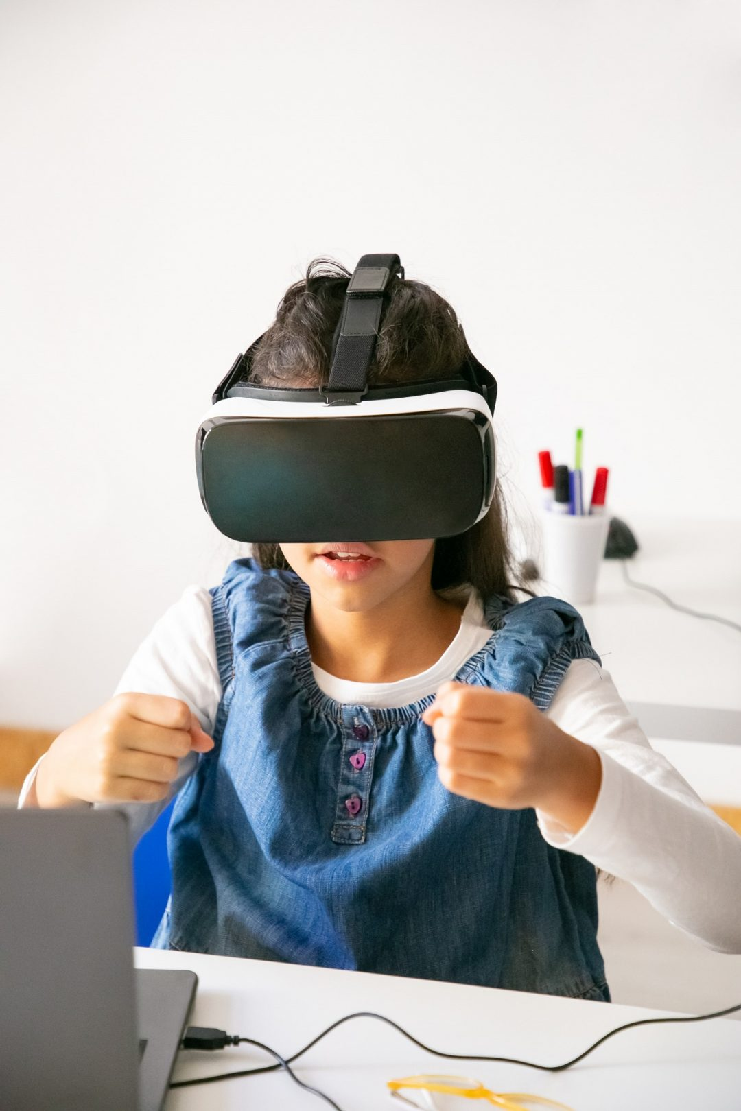 school girl playing with vr